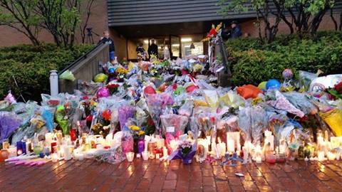 flowers and gifts in front of Moncton RCMP Office