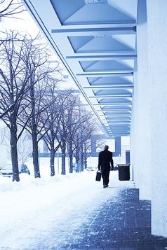 Worker walking in Winter